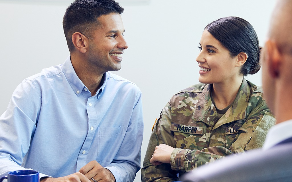 A female solider and her husband in a meeting to get a personal bank loan.