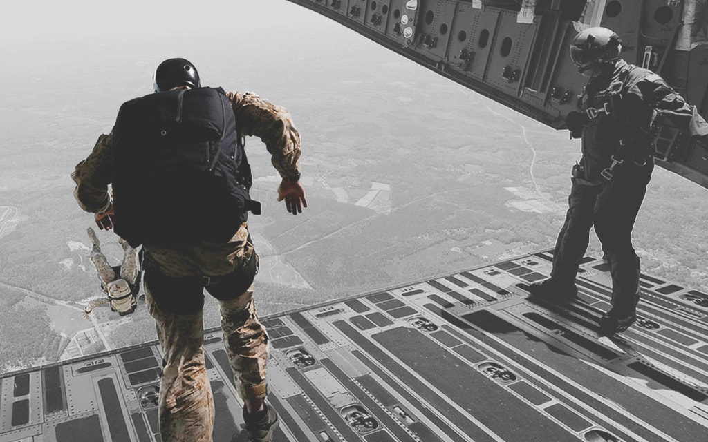 Greyed out image with Military jumping from plane with disability insurance coverage