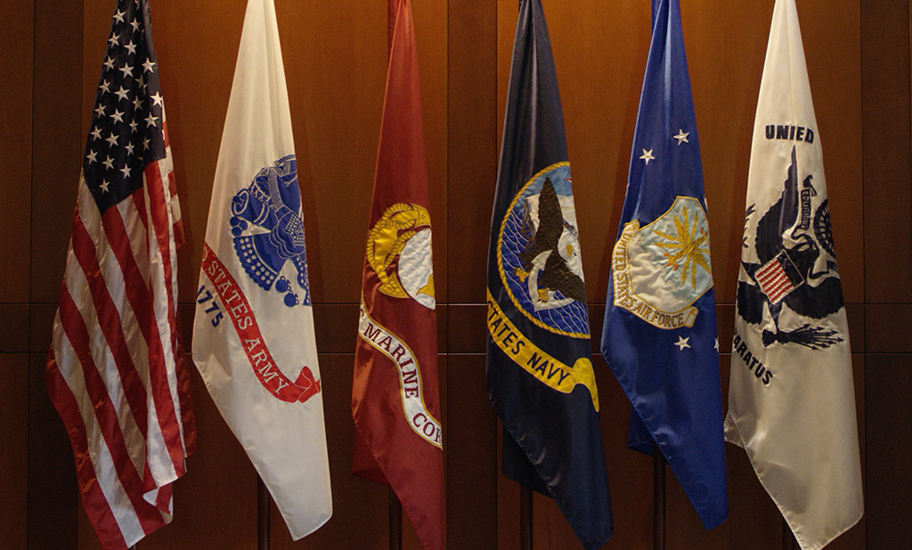 The US and military branch flags in a First Command office.